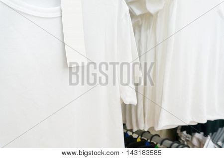 Blank Price Tag Hang Over White Tshirt On Hanger Shelf In Supermarket