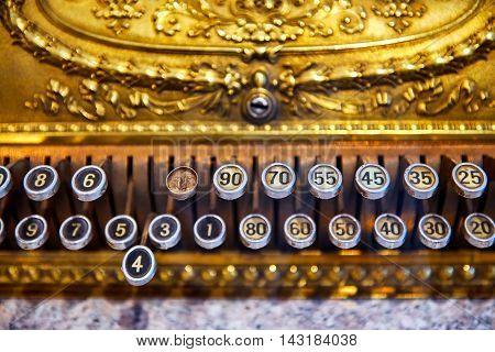 The keyboard keys old cash register. One button is broken.