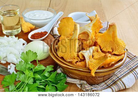 Chanterelle mushrooms and ingredients for cooking sauteed muchrooms.