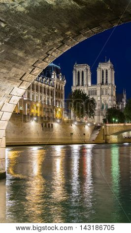 The Notre Dame cathedral at night Paris France.