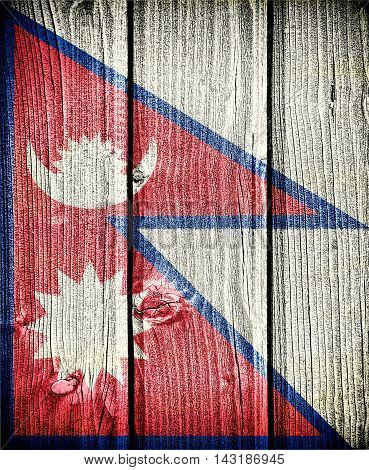 flag of Nepal painted on old grungy wooden background: 3d illustration