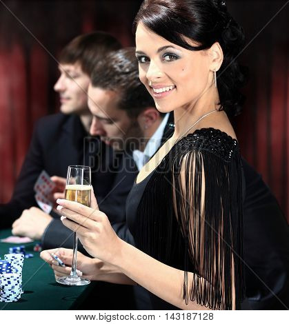 smiling girl with a glass at a party
