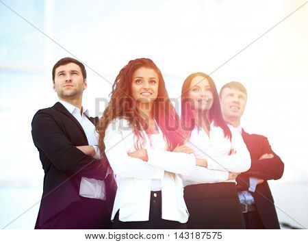 Young smiling businesswoman looking confident while being follow