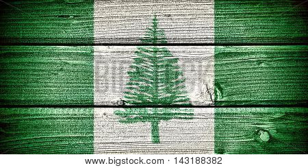 Flag of Norfolk Island painted on old grungy wooden background: 3d illustration