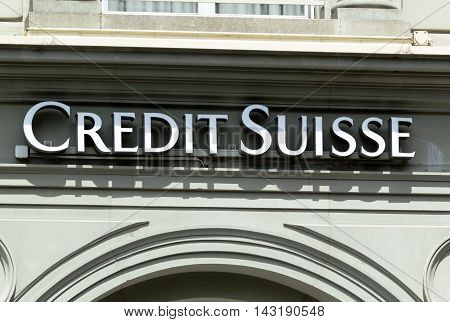 INTERLAKEN, SWITZERLAND - JUNE 5, 2016: Credit Suisse signboard over entrance of Credit Suisse office. Credit Suisse Group is a Swiss multinational financial services holding company, headquartered in Zurich, that operates the Credit Suisse Bank and other