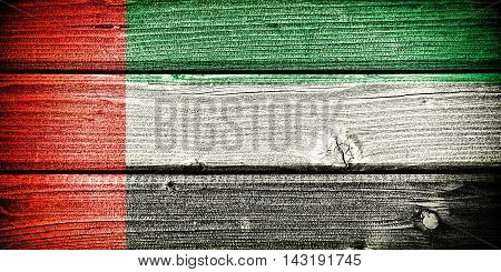 flag of the United Arab Emirates painted on old grungy wooden background: 3d illustration