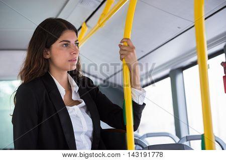 Contemplated Young Businesswoman Traveling By Public Transport