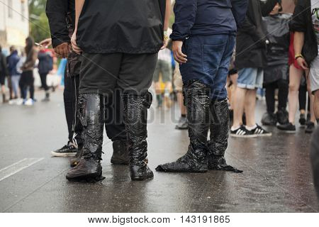 Bontida, Romania - July 16, 2016: People living heavy rainy days at Electric Castle Festival, one of the biggest music festivals in Romania