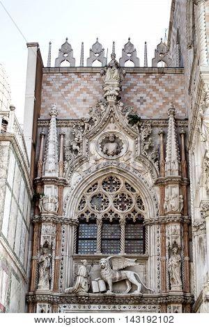 Facade of Porta della Carta of Doge's Palace, St Mark's Square. Venice. Italy
