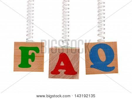 FAQ word on wooden cubes suspended on springs isolated on white