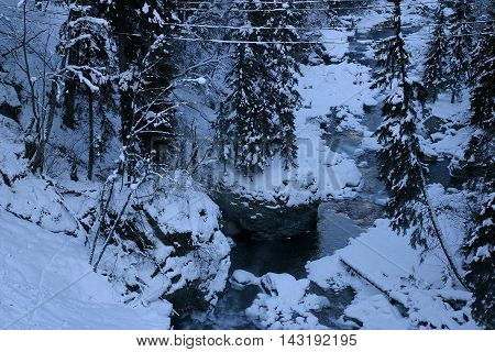 Winter mountains snow river stones forest pine V