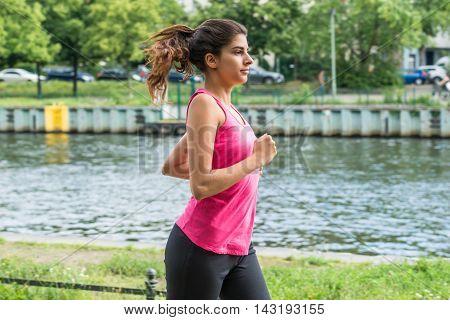 Young Confident Female Athlete On Morning Jog