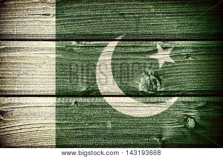 flag of Pakistan painted on old grungy wooden background:  3d illustration