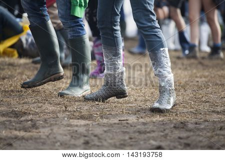 Bontida, Romania - July 17, 2016: People living heavy rainy days at Electric Castle Festival, one of the biggest music festivals in Romania