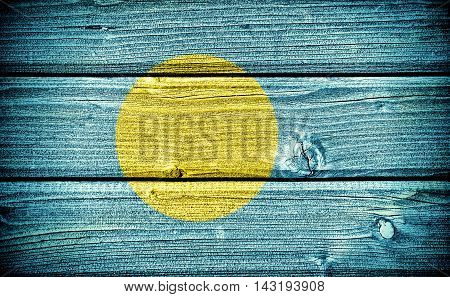 flag of Palau painted on old grungy wooden background:  3d illustration