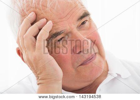 Close-up Photo Of A Contemplated Senior Man