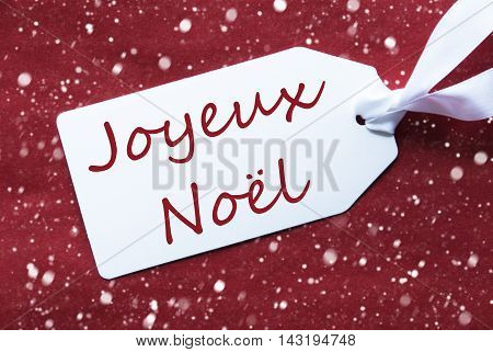 One White Label On A Red Textured Background. Tag With Ribbon And Snowflakes. French Text Joyeux Noel Means Merry Christmas