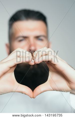 Bearded Man With Hands In Heart Shape