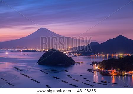 View of Mount Fuji with Suruga bay and Numazu town in twilight time