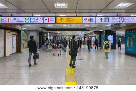 TOKYO JAPAN - APRIL 05 2016 : People hurry at Tokyo Station in Tokyo. It is the world's busiest transport hub with daily usage by up to million people.