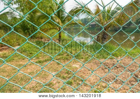 Green wire cage on nature background thai