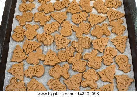 Gingerbread dough for Christmas cookies and cookie cutters.