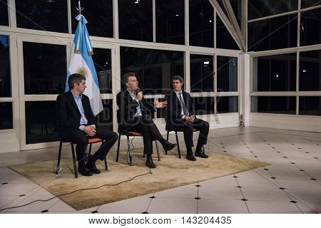 Olivos Argentina - May 6 2016: President of Argentina Mauricio Macri (C) Finance Minister Alfonso Prat-Gay (R) and Cabinet Chief Marcos Pena during a press conference at the presidential residence