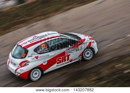 Moscow Russia - Apr 18 2015: Peugeot 208 R2 driver Gryazin Nikolay and co-driver Fedorov Yaroslav during the Rally Masters Show 2015 at the Krylatskoye District.