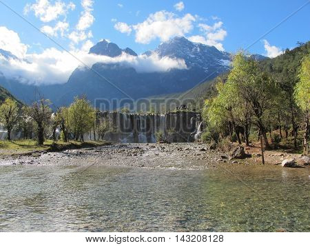 White Water River waterfall at the cliffs and brooks at the foot of Jade Dragon Snow Mountain Lijiang Yunnan China