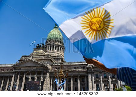 Buenos Aires Argentina - Dec 10 2015: Supporters of the newly elected Argentinean president wave flags on inauguration day at the the Congress.