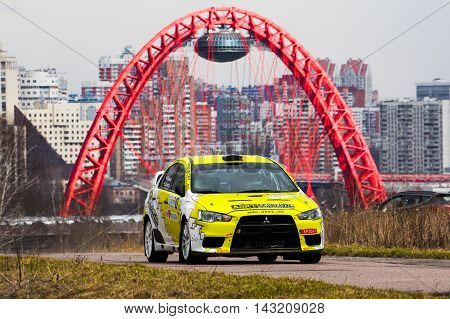 Moscow Russia - Apr 18 2015: Mitsubishi Lancer driver Kenavs Marcis and co-driver Gatis Cimdins during the Rally Masters Show 2015 at the Krylatskoye District.