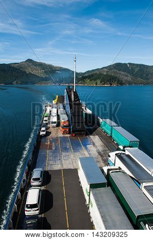 Ferry loaded with trucks and cars traveling from Wellington to Picton via Marlborough Sounds New Zealand