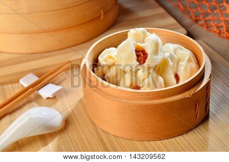 Braised pork buns in bamboo tray in restaurant