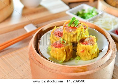 Crab Dumplings in chinese style in bamboo tray in asian restaurant