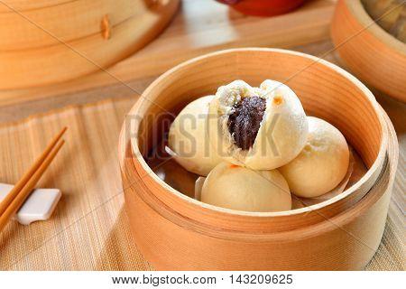 Dumplings of dense Dousha on bamboo tray in restaurant