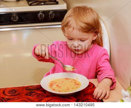 Girl-preschooler Eats A Tasty Meal In Cozy