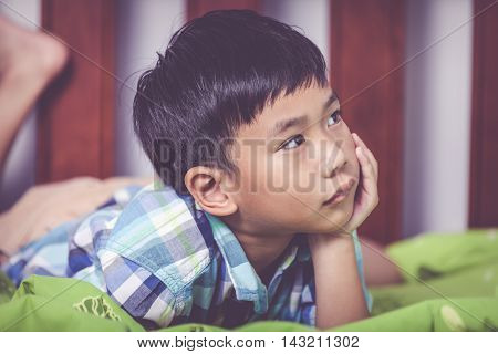 Closeup Sad Child Inside Bedroom. Problem Families Concept.