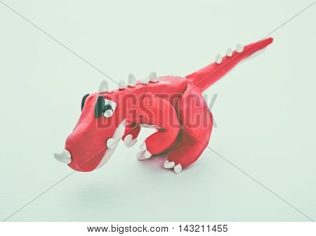 Red Dinosaur Clay Model. Play Dough Animal. Vintage Tone Effect.