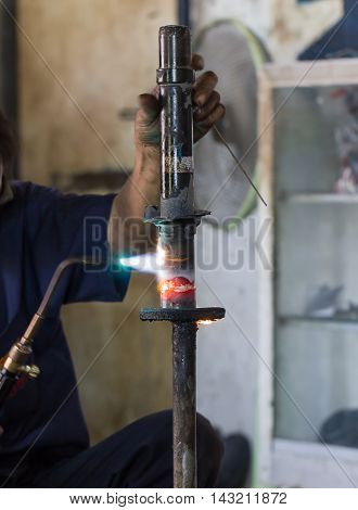 Welders Were Repairing Shock Absorbers