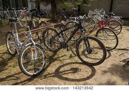 Dubna Russia - Jul 21 2014: Bicycles at bike-stand near the Tensor factory.