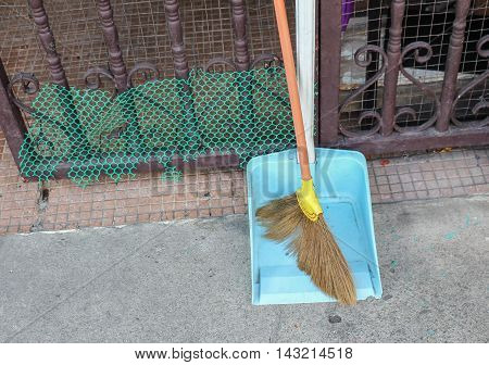 Broom made of grass and dustpan Set of cleaning home
