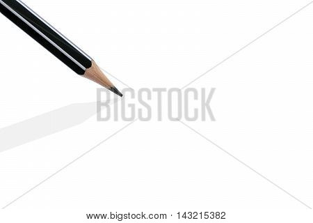 Closeup of a sharp pencil with shadow isolated on white background.