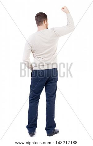 Back view of  man.  Raised his fist up in victory sign.   Rear view people collection.  backside view of person.  Isolated over white background. The bearded man in a white warm sweater triumphantly