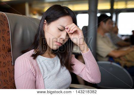 Woman feeling headache