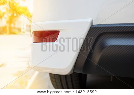 Closeup of a taillight on a modern white car. reflection light