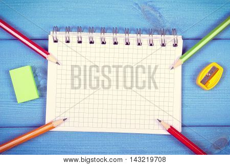 Colorful Crayons, Sharpener, Eraser And Notepad On Boards, School Accessories, Copy Space For Text