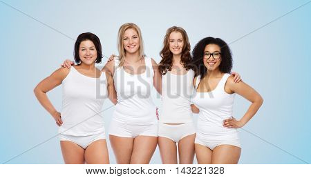 friendship, beauty, body positive and people concept - group of happy women different in white underwear over blue background