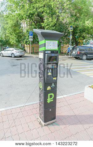 Moscow, Russia - July 07, 2016: Parking machine near a pedestrian crossing asphalt road