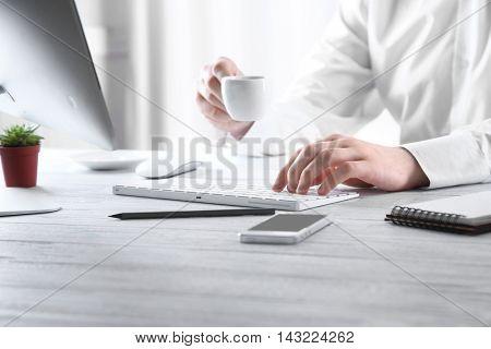Businessman working on computer indoors