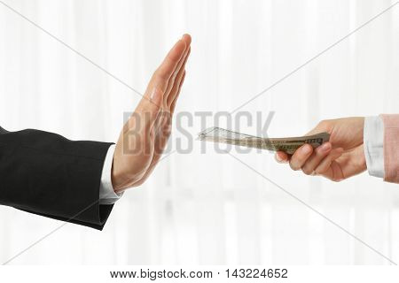 Businessman refusing money offered by woman closeup